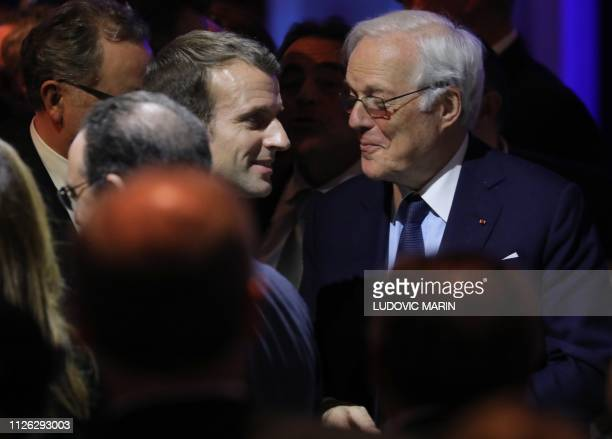French President Emmanuel Macron speaks with French banker David de Rothschild during the 34th annual dinner of the Representative Council of Jewish...