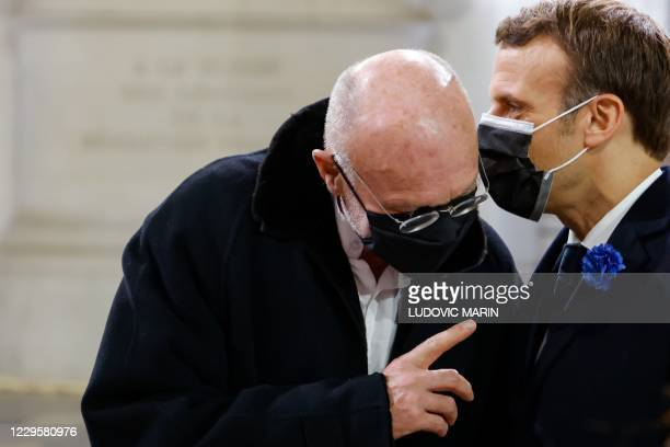 French President Emmanuel Macron speaks with German artist Anselm Kiefer during a ceremony at the Pantheon, honouring the World War I soldiers and...