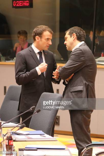 French president Emmanuel Macron speaks with Greek prime minister Alexis Tsipras during a meeting on the second day of a summit of European Union...
