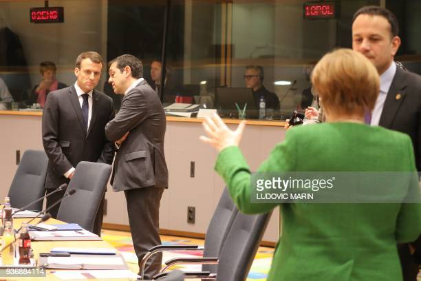 French president Emmanuel Macron speaks with Greek Prime minister Alexis Tsipras while German chancellor Angela Merkel speaks with Ireland's Prime...