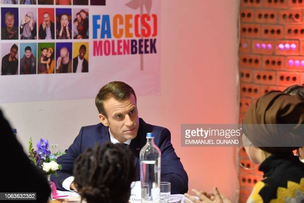 French President Emmanuel Macron speaks with inhabitants of the Brussels district of Molenbeek at the cultural center LaVallee a 6000 squaremetre...