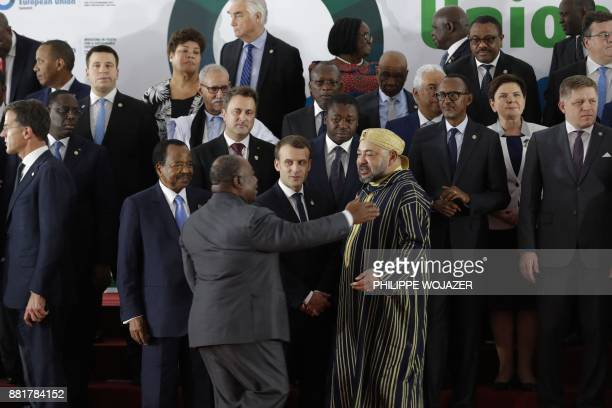 French President Emmanuel Macron speaks with King Mohammed VI of Morocco President of Gabon Ali Bongo Ondimba and Cameroon's President Paul Biya as...