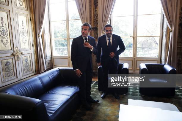 French President Emmanuel Macron speaks with Lebanese Prime Minister Saad Hariri prior to their meeting at the Elysee Palace in Paris France 20...