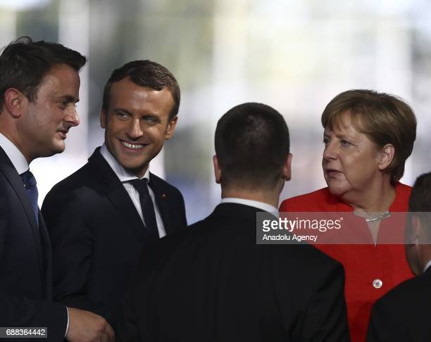 French President Emmanuel Macron speaks with Luxembourg's Prime Minister Xavier Bettel German Chancellor Angela Merkel and other officials during the...