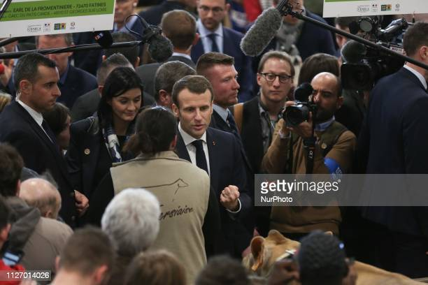 French President Emmanuel Macron speaks with people as he visits the 56th International Agriculture Fair at the Porte de Versailles exhibition center...