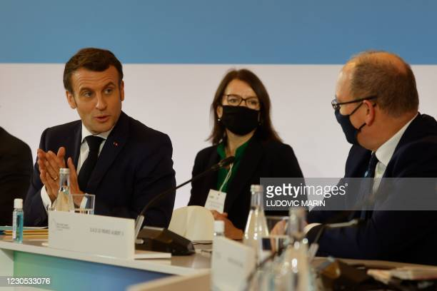 French President Emmanuel Macron speaks with Prince Albert II of Monaco , during the One Planet Summit, part of World Nature Day, at the Reception...