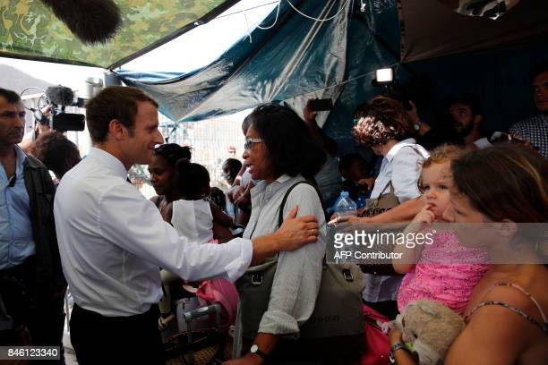 French President Emmanuel Macron speaks with residents during a visit to the French Caribbean island of St Martin on September 12 2017 French...