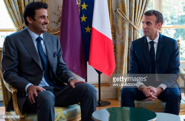French President Emmanuel Macron speaks with the Emir of Qatar Sheikh Tamim bin Hamad Al Thani at the Elysee Palace in Paris on July 6 2018
