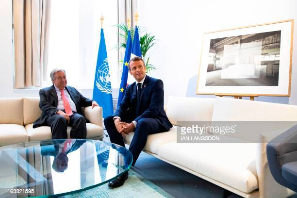 French President Emmanuel Macron speaks with United Nations SecretaryGeneral Antonio Guterres during a bilateral meeting as part of the second day of...
