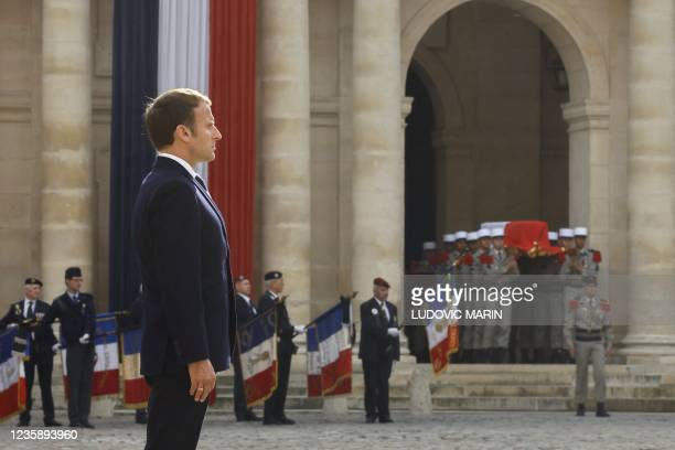French President Emmanuel Macron stands as Legionnaires carry the coffin during a national memorial service for Hubert Germain - the last surviving...