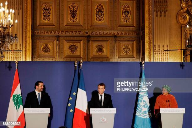 French President Emmanuel Macron stands between Lebanon's Prime Minister Saad Hariri and UN Deputy Secretary General Amina Mohammed as they attend...