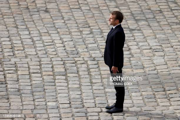 French President Emmanuel Macron stands during the national memorial service for Hubert Germain - the last surviving Liberation companion - at The...
