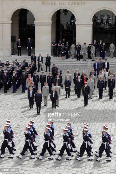French President Emmanuel Macron stands guard in front of French Defence Minister Florence Parly French Junior Defence Minister Genevieve...