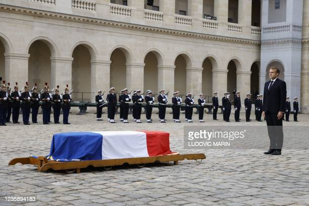 French President Emmanuel Macron stands in front of the coffin during a national memorial service for Hubert Germain - the last surviving Liberation...
