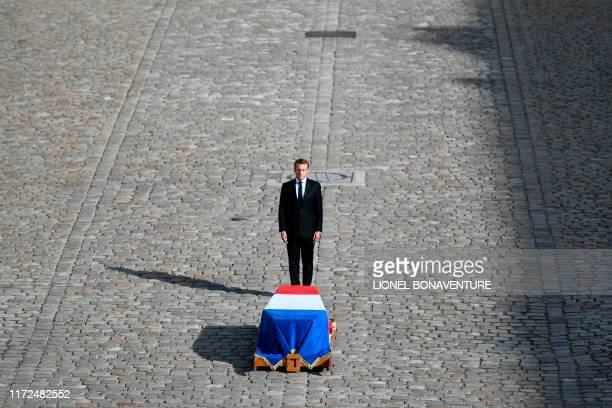 TOPSHOT French President Emmanuel Macron stands in front of the coffin of former French president Jacques Chirac during a military tribute at the...