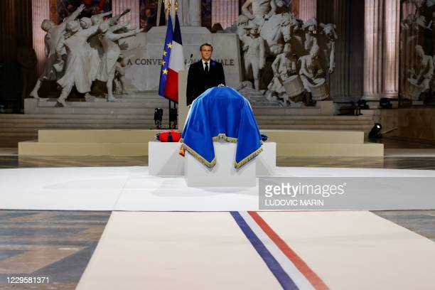 French President Emmanuel Macron stands in front of the coffin of French author Maurice Genevoix inside the Pantheon monument, during a ceremony...