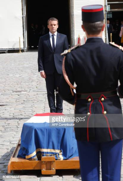 French President Emmanuel Macron stands in front of the flagdraped coffin of French politician and Holocaust survivor Simone Veil during a tribute...