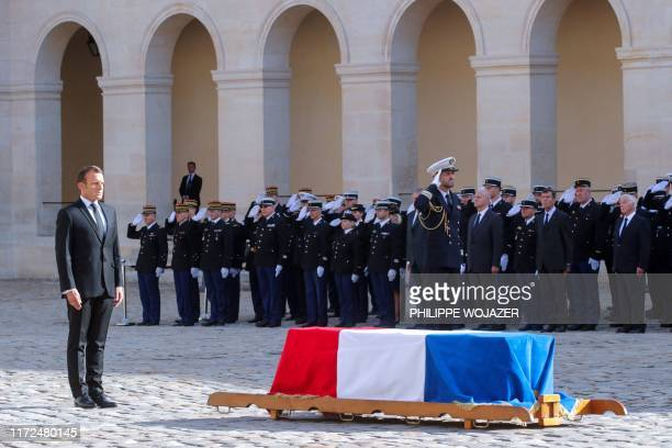 TOPSHOT French President Emmanuel Macron stands infront of the flagdraped coffin of late French President Jacques Chirac during a military tribute at...