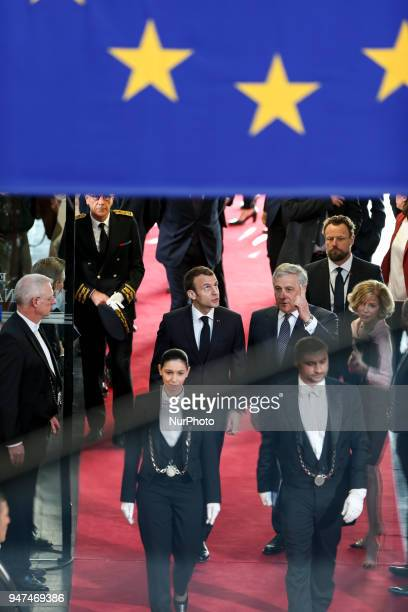 French President Emmanuel Macron stands next to European Parliament President Antonio Tajani on April 17 2018 at the EU parliament in the eastern...