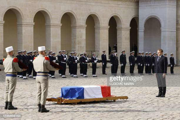French President Emmanuel Macron stands next to the coffin during a national memorial service for Hubert Germain - the last surviving Liberation...
