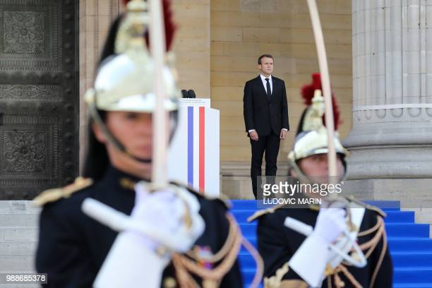 French President Emmanuel Macron stands on the steps of the Pantheon in Paris on July 1 2018 during the burial ceremony for former French politician...