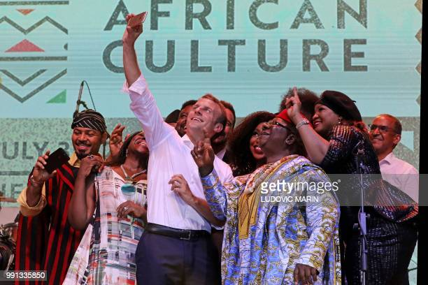 french president Emmanuel Macron takes a selfie with Nollywood artists during a live show in the AfriKa Shrine in Lagos on July 3 2018 French...