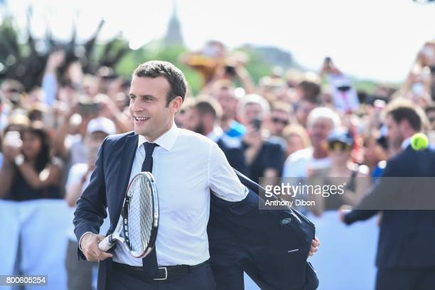 French president Emmanuel Macron takes off his jersey to play tennis during the Olympic Day Paris Olympic Park comes to life for Olympic Day on June...