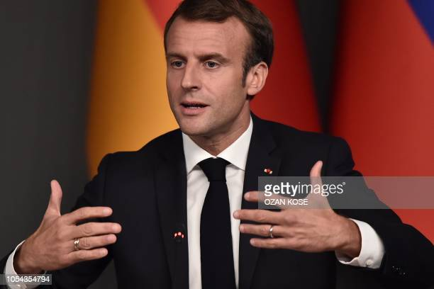 French President Emmanuel Macron takes part in a conference as part of a summit called to attempt to find a lasting political solution to the civil...