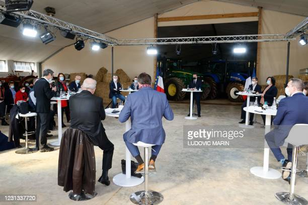 """French President Emmanuel Macron takes part in a debate at """"La Ferme d'Etaules"""" farm during an official one-day trip in Burgundy focused on..."""