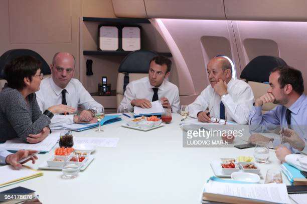 French President Emmanuel Macron takes part in a meeting in his presidential plane Airbus A330 with French Overseas Minister Annick Girardin French...