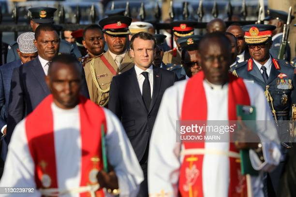 French President Emmanuel Macron takes part in a wreath laying ceremony at Jomo Kenyatta memorial in Nairobi on March 13 on the first day of a state...