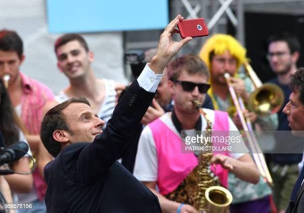 French president Emmanuel Macron takes with a band during a Charlemagne Prize event in Aachen on May 9 one day before Macron will be awarded with the...