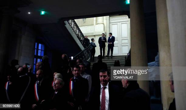 French President Emmanuel Macron talks with ChalonsenChampagne mayor Benoist Apparu during a visit to the mayor's house during a visit to Chalons en...