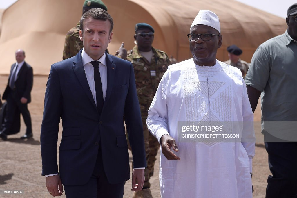 French President Emmanuel Macron (L) talks with Mali's President Ibrahim Boubacar Keita during a visit to the troops of France's Barkhane counter-terrorism operation in Africa's Sahel region in Gao, northern Mali, on May 19, 2017. The French president's visit in Mali is his first trip outside Europe since his inauguration on May 14, 2017. /