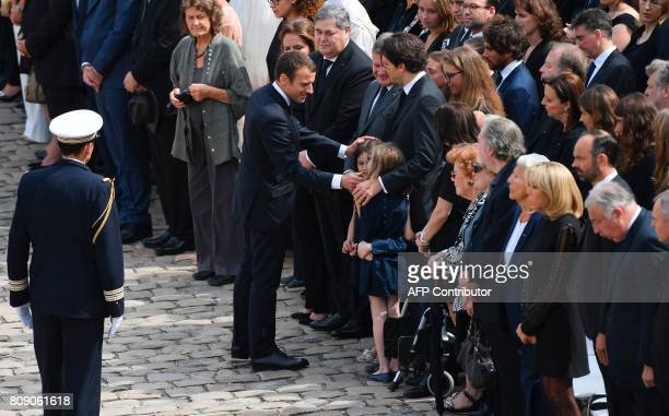 French President Emmanuel Macron talks with relatives of French politician and Holocaust survivor Simone Veil her sons PierreFrancois Veil and Jean...