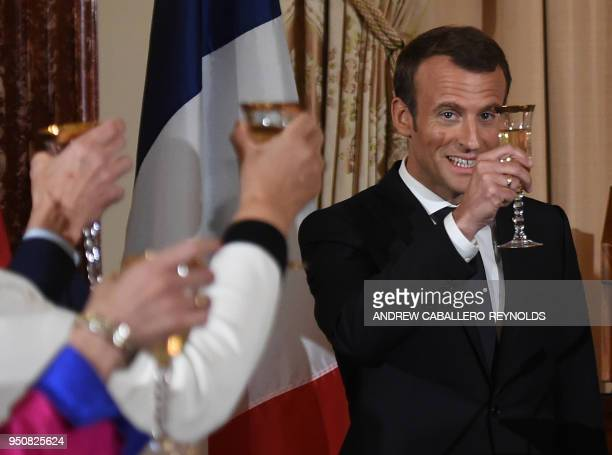 French President Emmanuel Macron toasts with US Vice President Mike Pence during a luncheon at the US State Department in Washington DC on April 24...