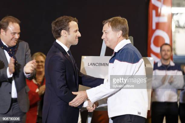 French President Emmanuel Macron unveils a plaque with Didier Leroy Executive Vice President of Toyota Motor Corporation as he visits Toyota's...