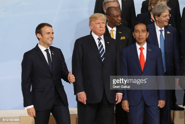 French President Emmanuel Macron US President Donald Trump and Indonesian President Joko Widodo attend the group photo on the first day of the G20...