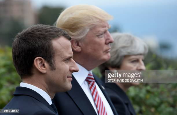 TOPSHOT French President Emmanuel Macron US President Donald Trump and Britain's Prime Minister Theresa May attend the Summit of the Heads of State...