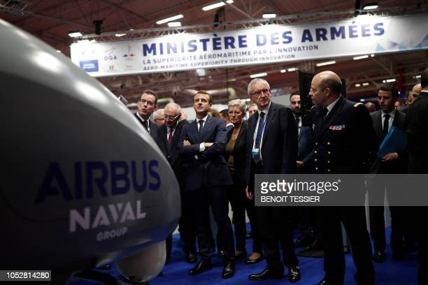 French President Emmanuel Macron visits a stand at Euronaval, the world naval defence exhibition in Le Bourget near Paris, on October 23, 2018.