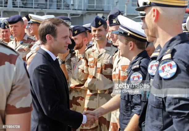 French President Emmanuel Macron visits French naval personnel deployed at a naval base in Abu Dhabi on November 9 2017 / AFP PHOTO / ludovic MARIN