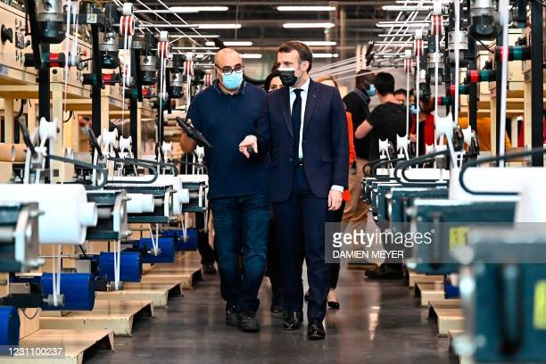 French president Emmanuel Macron visits the French hook and loop fastening systems company Aplix in Le Cellier, northwestern France on February 11,...