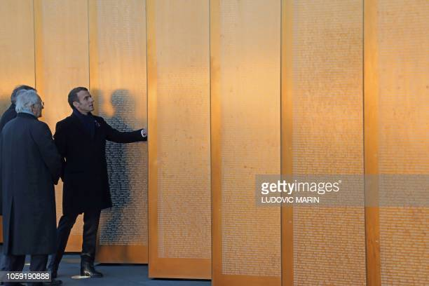 """French President Emmanuel Macron visits the """"Ring of Memory"""" international World War I memorial, at the Notre Dame de Lorette French war cemetery in..."""