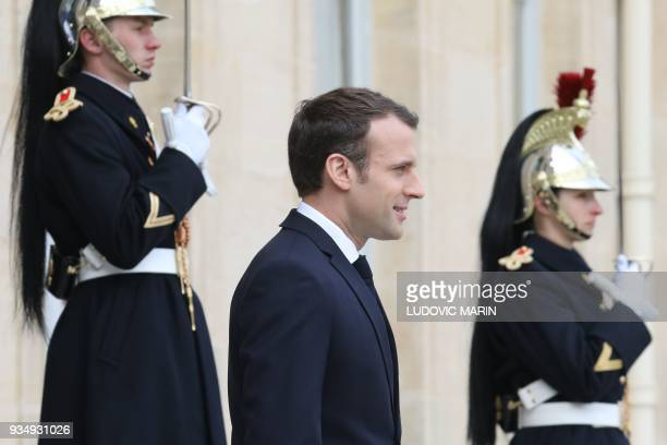 French president Emmanuel Macron waits for Luxembourg Prime Minister prior to their meeting at the Elysee presidential palace on March 20 in Paris /...