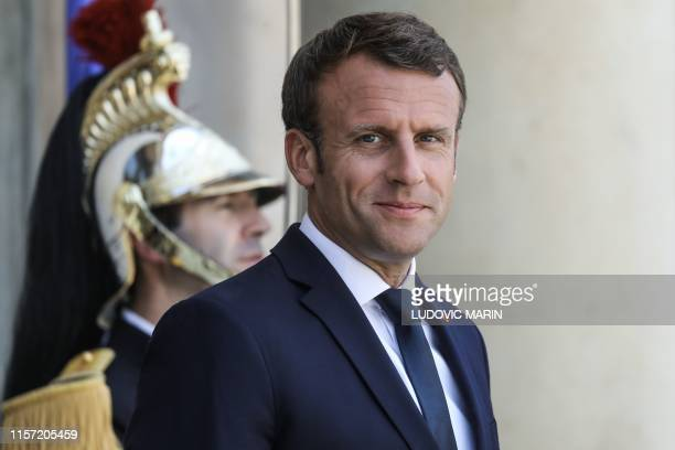 French President Emmanuel Macron waits for the arrival of Comoros President before a meeting at the Elysee presidential palace in Paris on July 22...