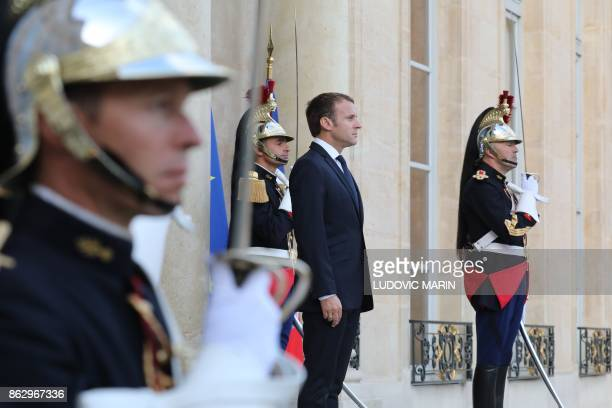 French president Emmanuel Macron waits for the arrival of Director General of the International Atomic Energy Agency at the Elysee palace in Paris on...