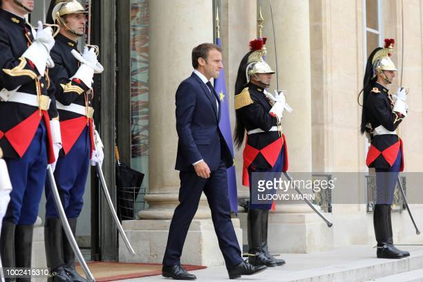 French President Emmanuel Macron waits for the arrival of his Azerbaijan counterpart for a meeting at the Elysee Presidential Palace in Paris on July...