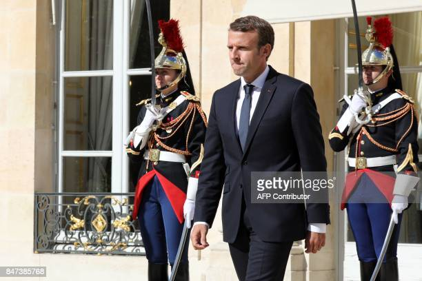 French President Emmanuel Macron waits prior to welcome Qatar's Emir upon his arrival at the Elysee palace for a meeting on September 15 in Paris /...