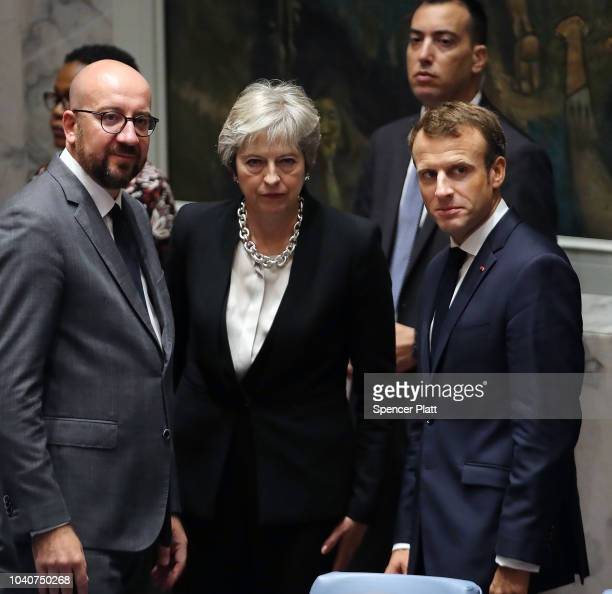 French President Emmanuel Macron waits with British Prime Minister Theresa May and Prime Minister of Belgium Charles Michel for the arrival of...