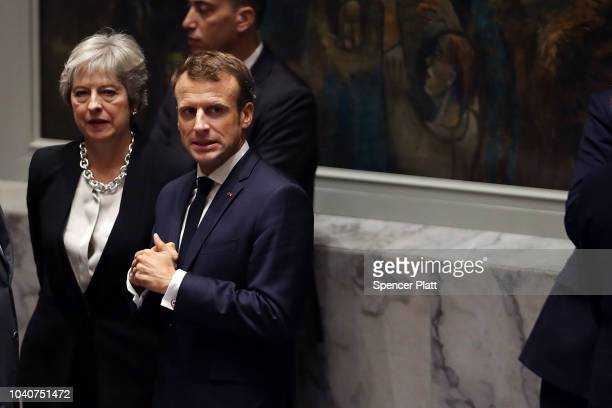 French President Emmanuel Macron waits with British Prime Minister Theresa May for the arrival of President Donald Trump who is chairing a United...